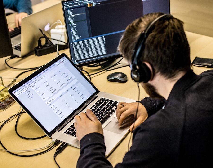 Developer coding on a laptop