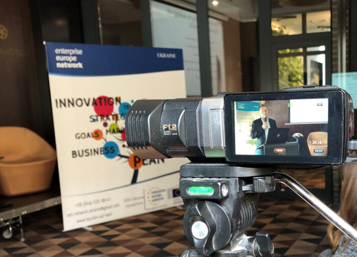 Camera filming a conference talk