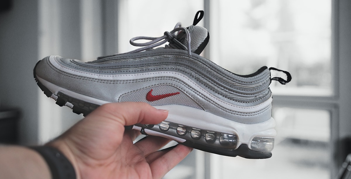 Man holding a Nike sneaker